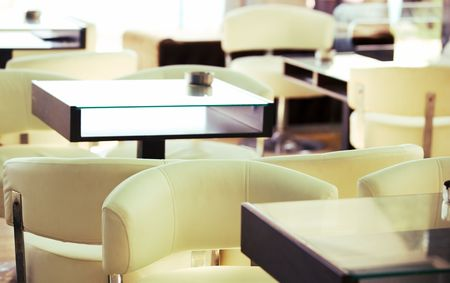 cafe interior abstract, shallow DOF, focus on chair photo