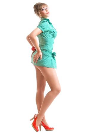 blonde in green dress posing, over white photo