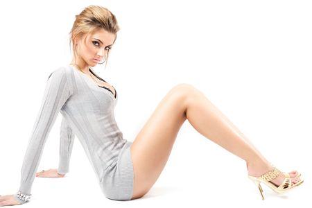 sit shape: young beautiful model posing, over white, studio shot Stock Photo