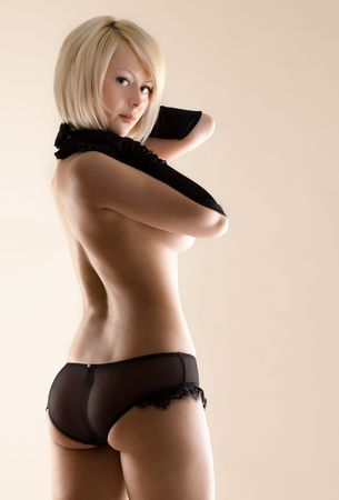 young sexy blonde posing to the camera, studio shot