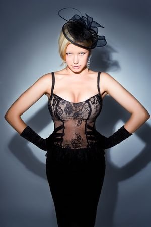 gorgeous blonde posing, spot lighting, studio shot photo