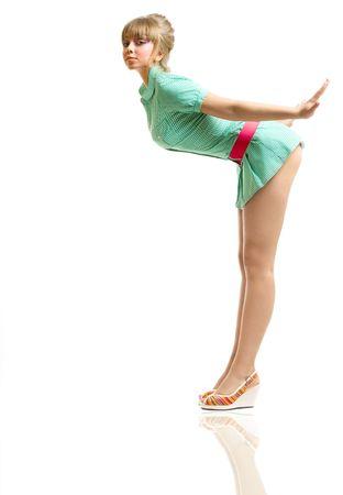 굽힘: blonde in green dress posing, over white 스톡 사진