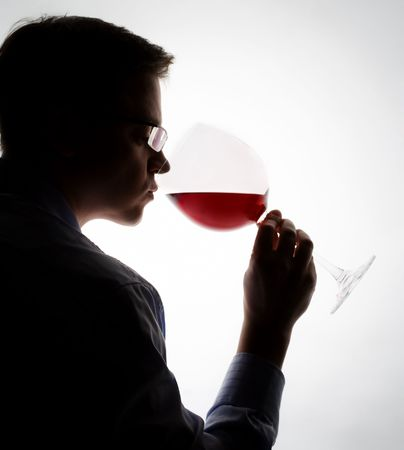 palate: young expert sampling red wine Stock Photo