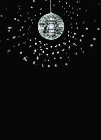 retro disco: spinning discoball, over black background, space for text Stock Photo