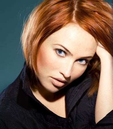 close up portrait of young beautiful red haired woman photo