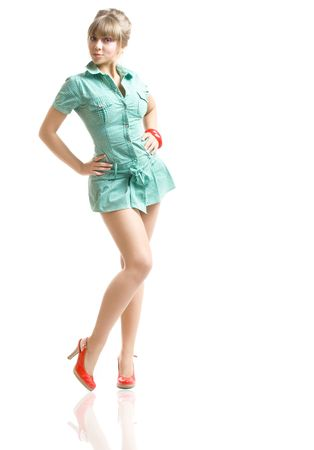 young blonde in green dress posing, over white photo