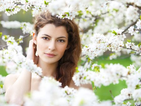 portrait of young woman in the garden, shallow DOF photo