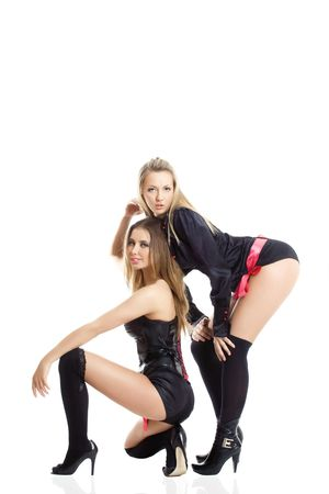 two young show dance girls posing over white photo