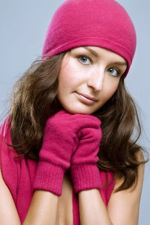 young brunette woman posing in winter accessories photo
