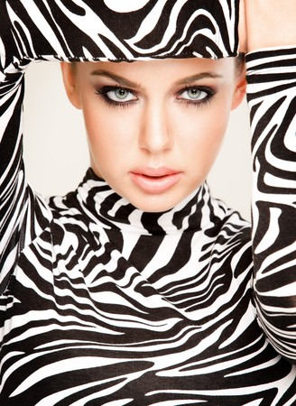 model posing: gorgeous young woman posing in zebra pattern outfit