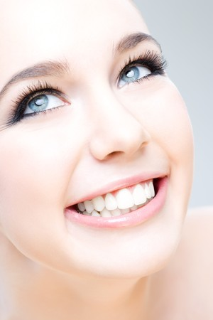 young caucasian woman smiling happily, beauty shot Stock Photo - 7741605
