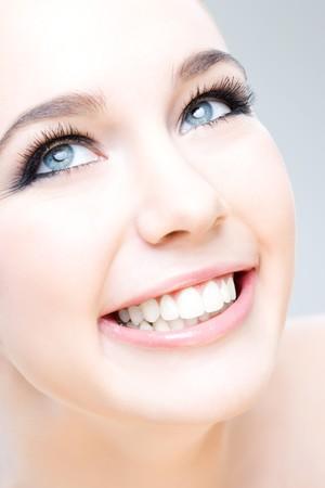 beauty shot: young caucasian woman smiling happily, beauty shot