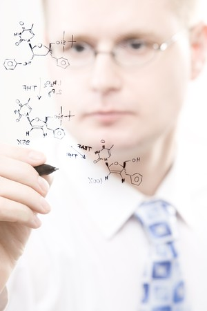 young chemist writing organic chemistry reaction equation, selective focus photo