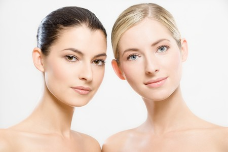 studio portrait of two young beautiful women Stock Photo - 8015440