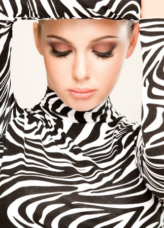 gorgeous young woman posing in zebra pattern outfit