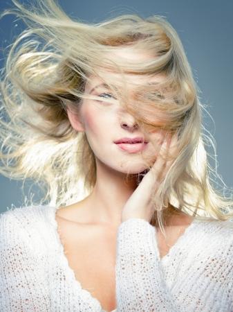 blowing wind: close up portrait of young blonde, with blowing hair