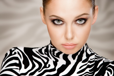 gorgeous young woman posing in zebra pattern outfit photo