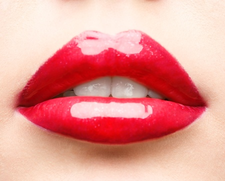close up studio shot of red glossy lips Stock Photo - 8589530