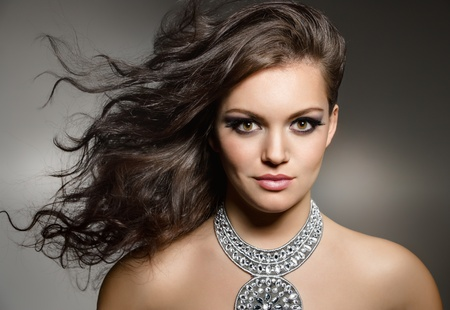 studio portrait of young gorgeous brunette with evening make up photo