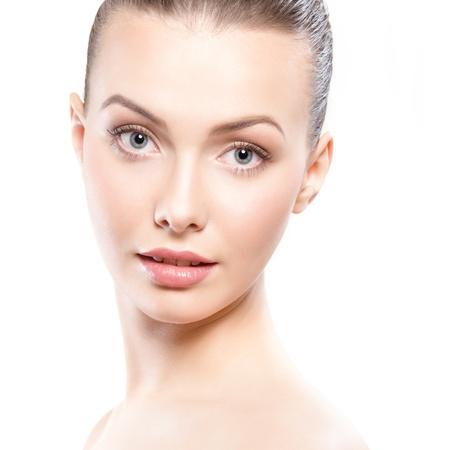studio portrait of young beautiful woman - clean beauty concept photo