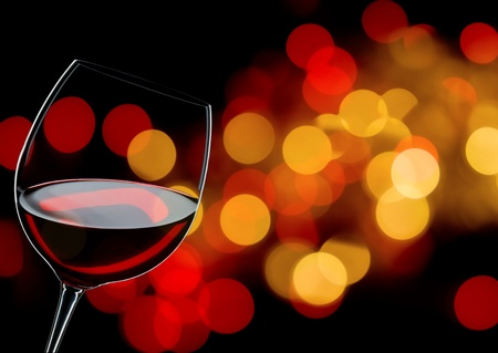 wine red: glass of red wine close up, background lights  Stock Photo
