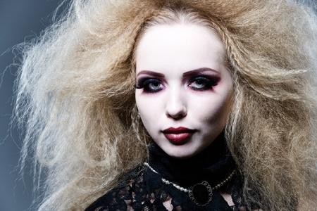 studio shot of young woman, vampire style photo