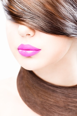 close up studio portrait of young woman, wearing lilac lipstick photo
