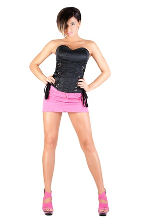 young model in pink mini skirt and black corset posing, isolated on white Stock Photo