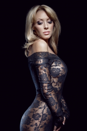 erotic dress: gorgeous blonde in lace dress, isolated on black, studio shot