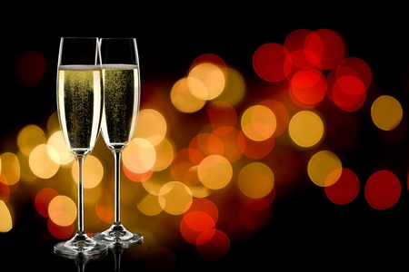 champagne flute: two glasses of sparkling wine with copyspace and abstract lights background