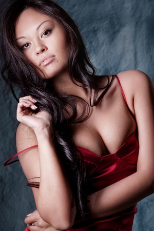 brunette in red evening dress photo