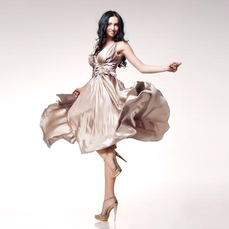brunette in waving dress
