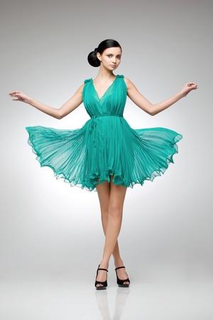 brunette in teal dress photo