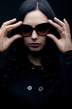 brunette wearing sunglasses photo