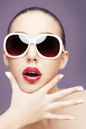 young woman wearing sunglasses Standard-Bild