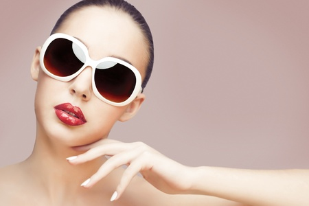 young woman wearing sunglasses 스톡 콘텐츠