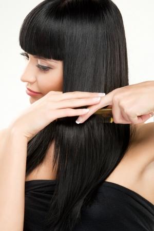 brunette brushing hair photo