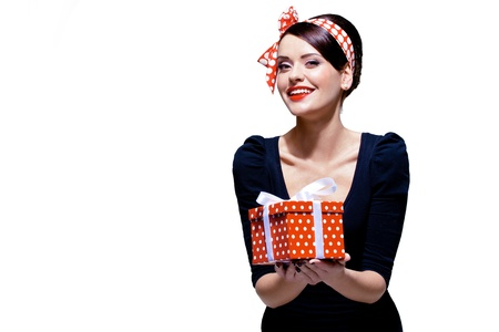 retro housewife: gorgeous brunette with gift box Stock Photo