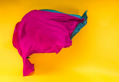 highspeed: abstract pieces of fabric flying, high-speed studio shot