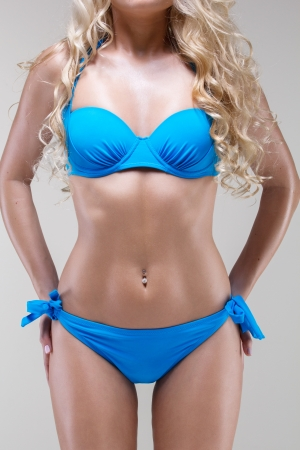 blue bikini: close up studio shot of slim woman wearing blue bikini Stock Photo
