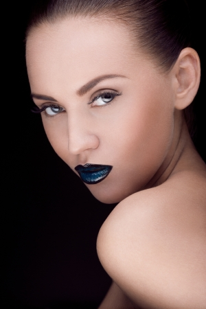 close up portrait of young caucasian brunette with dark makeup photo