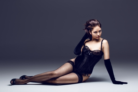 beautiful caucasian brunette in sexy lingerie posing in the studio