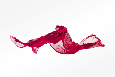levitating: abstract pieces of fabric flying, high-speed studio shot