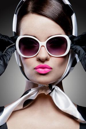 young stylish caucasian woman posing, retro styling