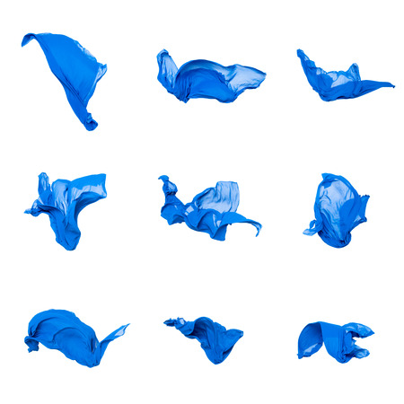 set of abstract pieces of blue fabric flying, high-speed studio shot