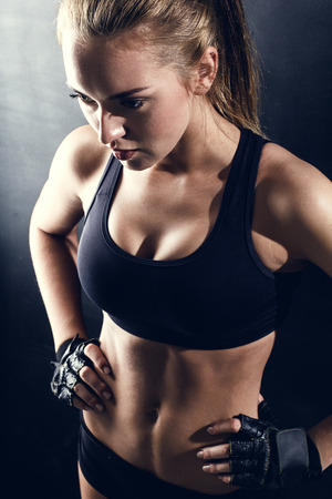 sweat girl: attractive fitness woman, trained female body, lifestyle portrait, caucasian model Stock Photo