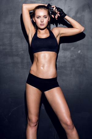 'fit body': attractive fitness woman, trained female body, lifestyle portrait, caucasian model Stock Photo