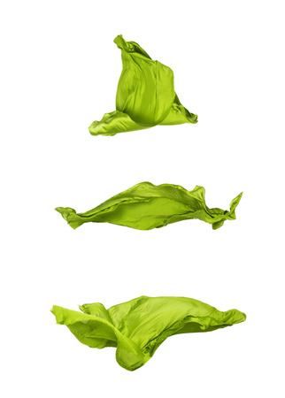 abstract pieces of olive fabric flying, high-speed studio shot