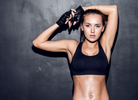 fitness workout: attractive fitness woman, trained female body, lifestyle portrait, caucasian model Stock Photo