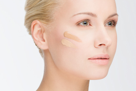 foundations: close-up portrait of young beautiful woman with cosmetic foundation